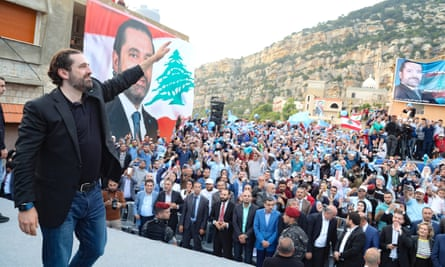 Lebanon's prime minister, Saad Hariri, waves during an election campaign rally in the northern town of Deniyeh.
