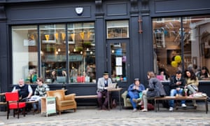 People relax outside the Covent Garden branch of Timberyard, a hybrid coffee shop and workspace.