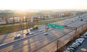 At dawn, cars drive down the US 9 highway past Newark Liberty International Airport, Newark, New Jersey, US.