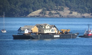 Home floats: a barge carries heritage homes from Canada to the US.
