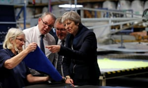 Theresa May meets staff and views samples of leather during her visit to the Scottish Leather Group.
