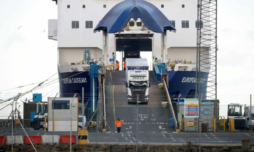 Lorries disembark from a ferry at the port of Larne in Northern Ireland