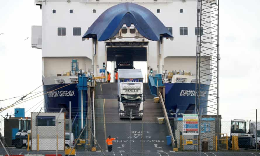 Lorries leave a ferry at the Port of Larne, Northern Ireland