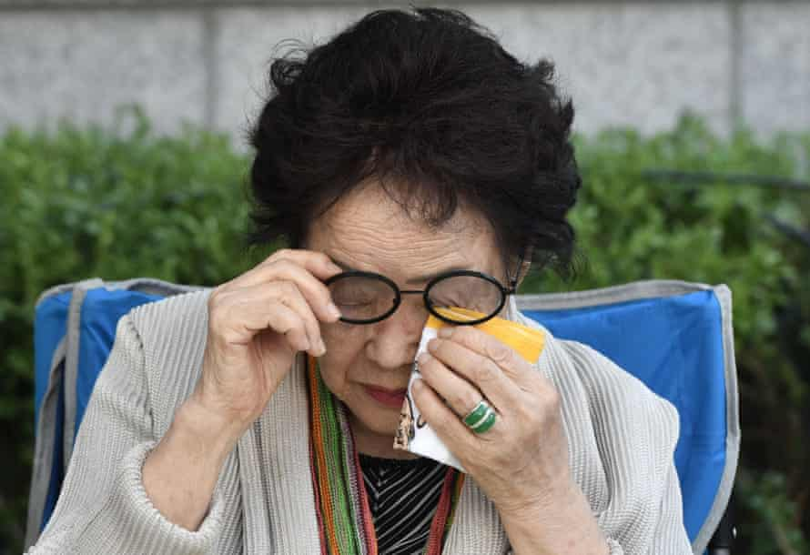 "Former South Korean ""comfort woman"" Lee Yong-soo, wipes away her tears during a demonstration demanding the Japanese government's formal apology near the Japanese embassy in Seoul on September 18, 2019."