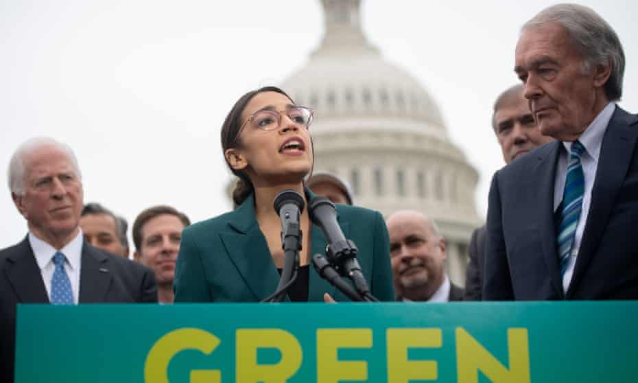 Alexandria Ocasio-Cortez speaks about the Green New Deal with Ed Markey outside the US Capitol in Washington DC, on 26 March.