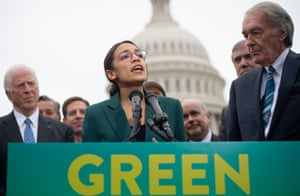 The Democratic congresswoman Alexandria Ocasio-Cortez, centre, at a press conference to announce Green New Deal plans