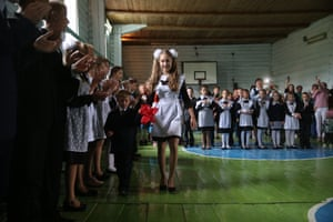 Mari El, Russia: children attend a ceremony marking the beginning of a new academic year at a rural school