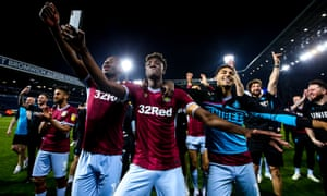 Keinan Davis, Tammy Abraham and Andre Green of Aston Villa celebrate after their side win on penalties against West Bromwich Albion to book their place in the Championship Playoff Final.