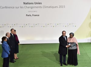 Francois Hollande greets Nkosazana Dlamini-Zuma, right, head of the African Union Commission, as she arrives to attend the open day talks at COP21 in Paris