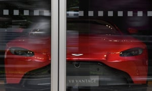 An Aston Martin V8 Vantage parked in a showroom in central London