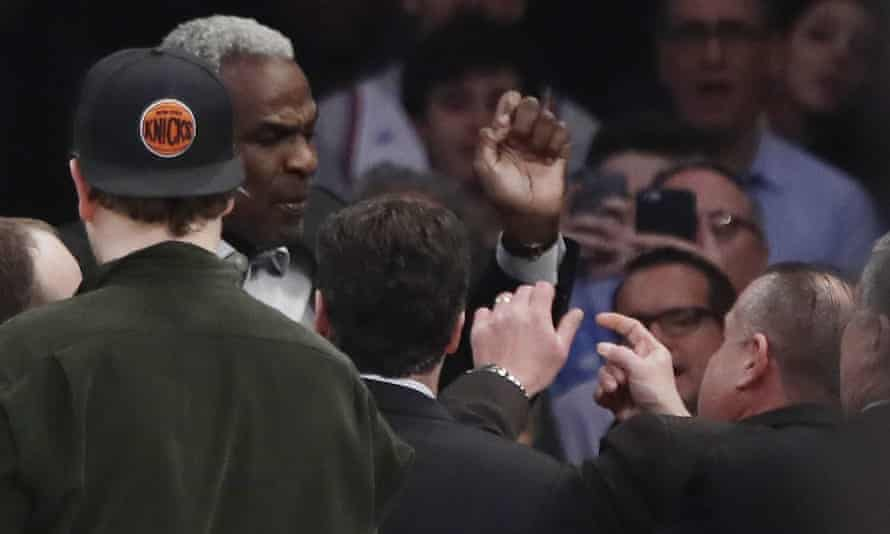 Charles Oakley exchanges words with a security guard during the first half of the game against the Clippers.