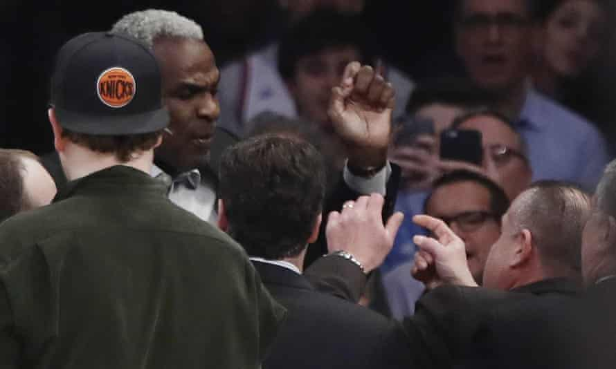 Charles Oakley exchanges words with a security guard before being ejected from a Knicks game in 2017