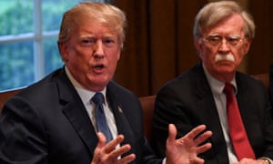 Donald Trump, left, flanked by national security advisor John Bolton, right, speaks at the White House in April 2018.