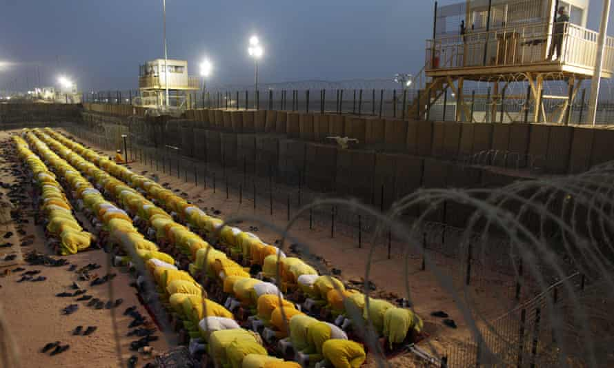 Detainees pray at Camp Bucca, the former US military prison in Iraq, in 2009.