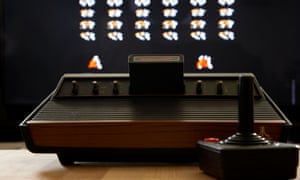 Atari VCS 2600 console and joystick for playing Space Invaders.