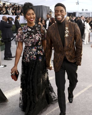 Chadwick Boseman and his partner Taylor Simone Ledward arrive at the 25th annual Screen Actors Guild Awards in Los Angeles on 27 January 2019.