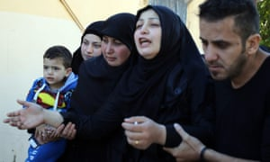Zahra Atat, second from right, mourns her husband, Adel Tormos, who had tried to stop the second bomber entering the Shiite mosque.
