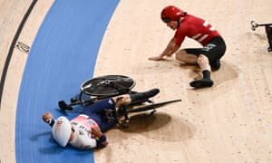 Frederik Madsen of Denmark and Charlie Tanfield of Great Britain crash during the men's team pursuit first round heat four.