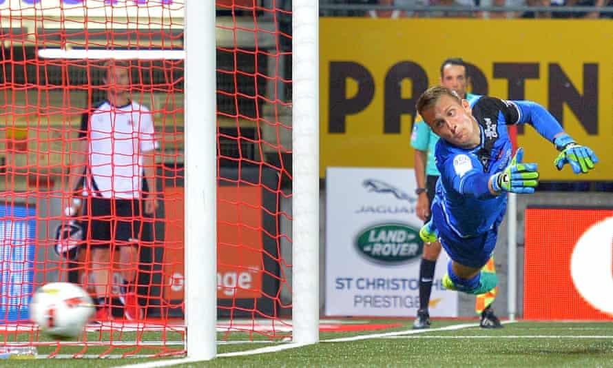 Guingamp's Danish goalkeeper Karl-Johan Johnsson saves a penalty during a Ligue 1 game against Nancy