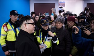 A Kim Jong Un impersonator is forced out in the final period of the women's ice hockey match between Japan and the Unified Korean team.