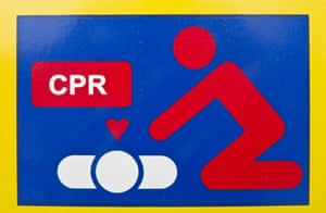 CPR symbolic diagram of an automatic external defibrillator machine on a street sign.