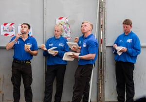 Security guards eat lunch during Katy Perry