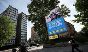 A government and NHS Test and Trace advert on a billboard in London.