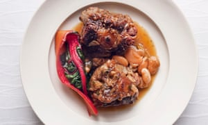 Nigel Slater's oxtail with butter beans and sherry on a round plate