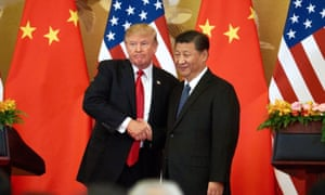 Donald Trump and China's President Xi Jinping shake hands at a press conference following their meeting at the Great Hall of the People in Beijing in 2017