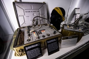 A Soviet Strizh radio transmitter and receiver, with headphones and power supply. Housed in a metal box fitted with backpack straps