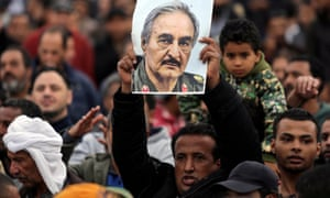 A man holds a poster of the eastern Libyan military commander Khalifa Haftar at a rally in Benghazi.