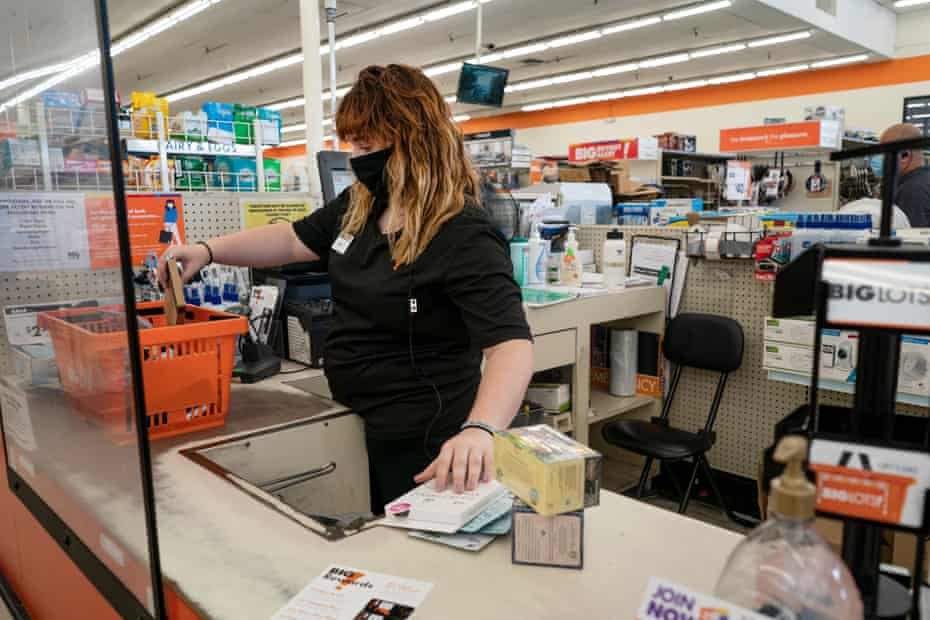 Sierra works the counter during her shift at Big Lots. Orange County, California.