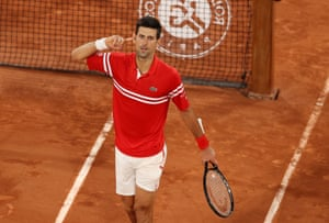 Novak Djokovic gestures to the crowd as he celebrates winning the third set.
