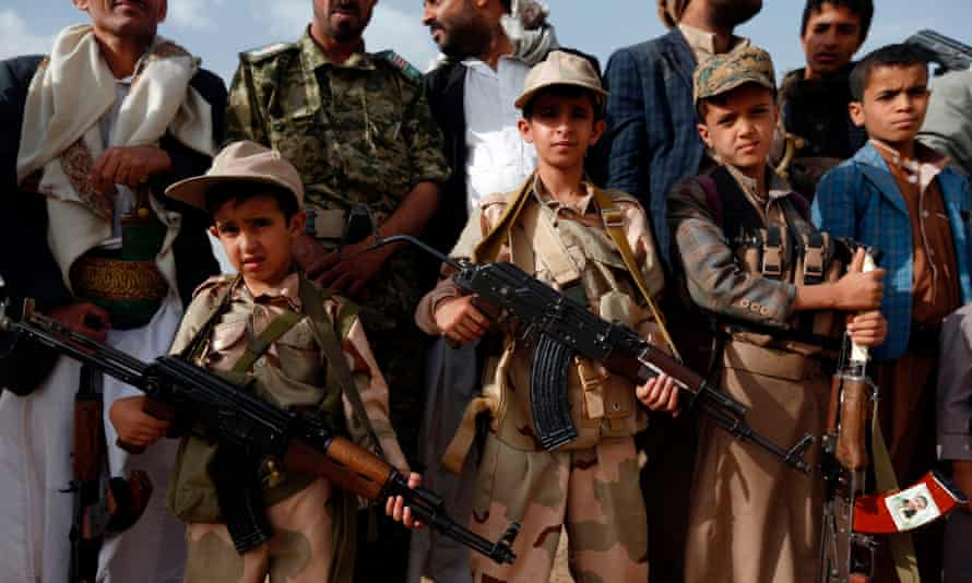 Yemeni children carrying weapons take part in a gathering organised by Shiite Huthi rebels to mobilise more fighters to fight pro-government forces, on 18 June 2017 in the capital Sana'a.