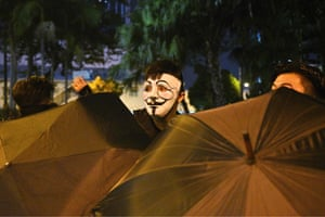 Umbrellas and masks were plentiful at a protest in the Wanchai district.