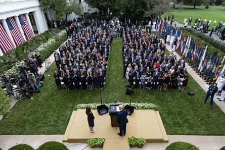 Donald Trump, center, stands with Amy Coney Barrett at an event to announce his supreme court nomination in the Rose Garden at the White House on 26 September.