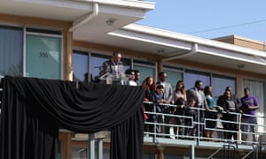 The Reverend Jesse Jackson speaks, as his family stands near him, from the balcony outside room 306 at the Lorraine Motel, where he was when Martin Luther King Jr was assassinated on April 4, 1968 in Memphis, Tennessee.