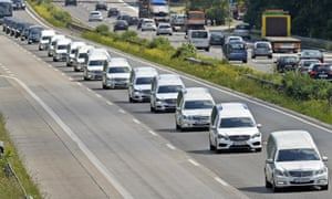 A convoy of hearses on its way to Haltern, Germany, where students were laying flowers and lighting candles in memory of their dead friends.