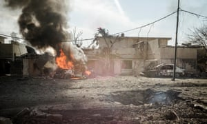 An IS car bomb targeting Iraqi troops exploded in the streets of Mosul