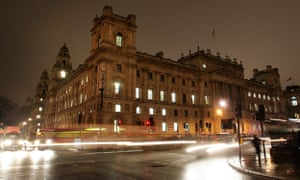 Traffic passes the HM Treasury on Whitehall in the evening on November 20, 2007 in London.