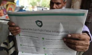 Man reading newspaper with full-page WhatsApp ad