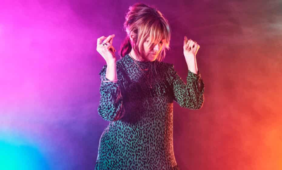 Clubber Victoria Saunders dancing against multicoloured background