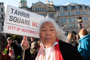 Visiting the Occupy London camp at St Paul's on her 80th birthday holding a mocked-up London street sign saying Tahrir Square.