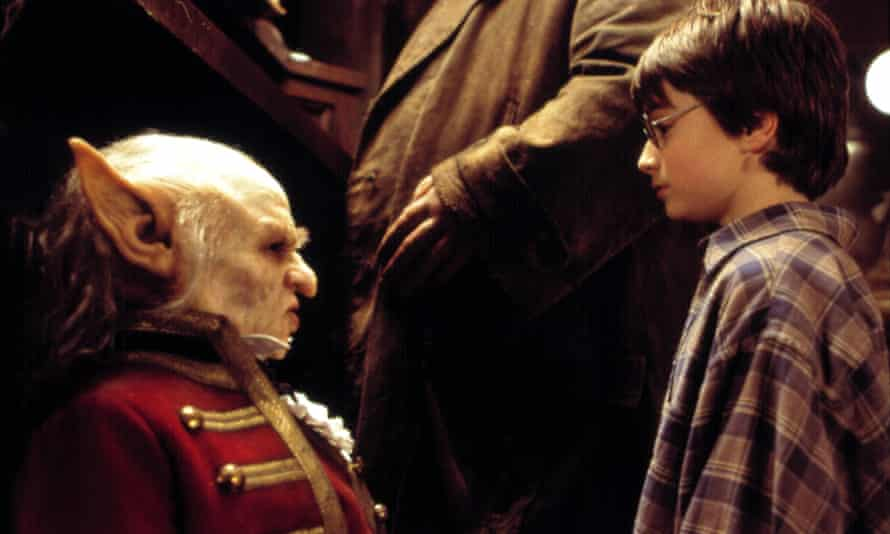Verne Troyer and Daniel Radcliffe, right, in Harry Potter and the Philosopher's Stone, 2001.
