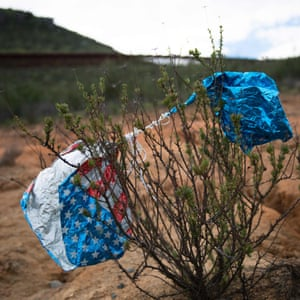 An American flag balloon rests in a bush near the border in Tecate, California