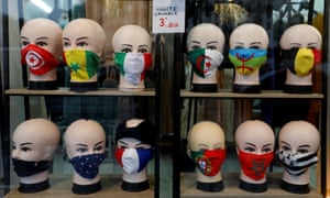 Protective face masks with flags design on display in a shop in Paris