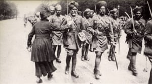 a French woman thanks Indian sepoys marching through Paris in 1916.