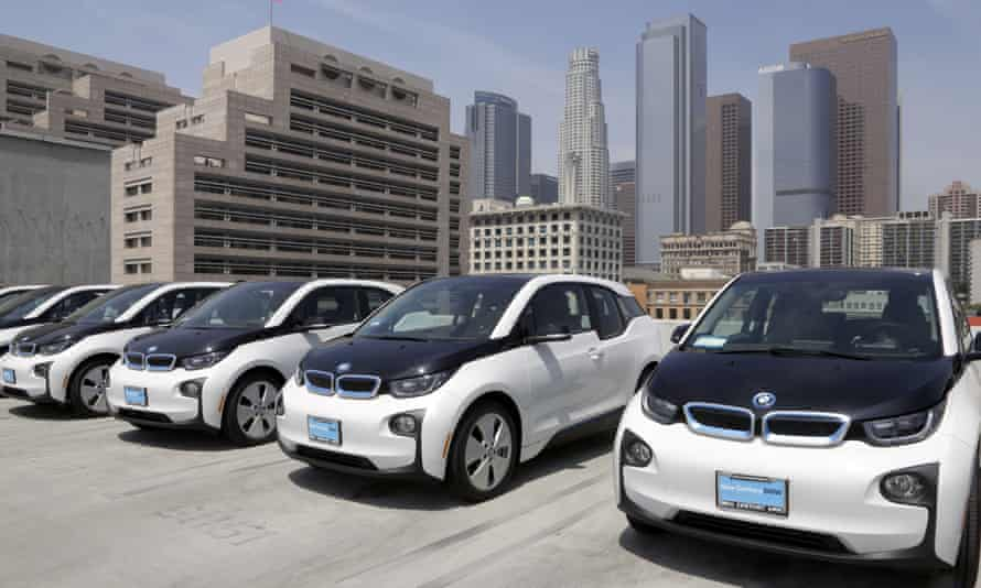 Electric cars are parked atop the police department's lot in Los Angeles.