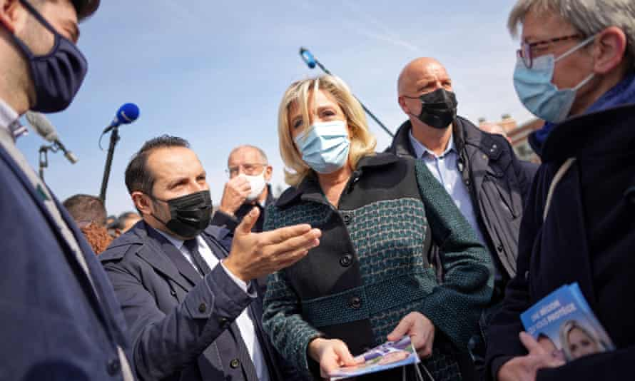 Marine Le Pen, surrounded by campaigners