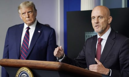 Donald Trump listens as Stephen Hahn, commissioner of the US Food and Drug Administration, speaks during a media briefing on 23 August.